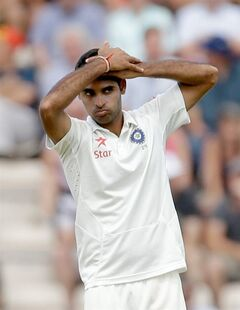 India bowler Bhuvneshwar Kumar holds his arms up to his head in frustration after pitching a delivery during the first day of the third cricket test match of the series between England and India at The Ageas Bowl in Southampton, England, Sunday, July 27, 2014. (AP Photo/Matt Dunham)