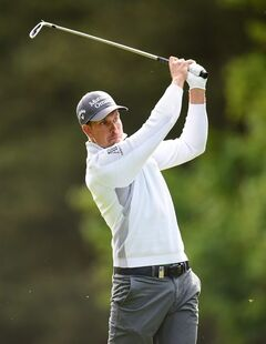Sweden's Henrik Stenson plays a shot with an iron during day two of the BMW PGA Championship at the Wentworth Club, Virginia Water, England Friday May 23, 2014. (AP Photo/Adam Davy/PA) UNITED KINGDOM OUT NO SALES NO ARCHIVE