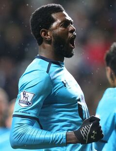 Tottenham Hotspur's Emmanuel Adebayor celebrates during their English Premier League soccer match against Newcastle United at St James' Park, Newcastle, England, Wednesday, Feb. 12, 2014. (AP Photo/Scott Heppell)