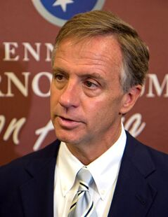 File-This June 21, 2011, file photo shows Republican Gov. Bill Haslam speaking to reporters after a speech at Lipscomb University in Nashville, Tenn. Authorities say the truck-stop company owned by Cleveland Browns owner Jimmy Haslam and Tennessee Gov. Bill Haslam has agreed to pay $92 million in fines for cheating customers out of promised rebates and discounts. The agreement was signed by attorneys for the nation's largest diesel retailer Friday. The agreement does not protect any individual at Pilot from prosecution and requires the company to cooperate with an ongoing investigation of current and former employees. Jimmy Haslam has said he was unaware of the scheme. Tenn. Gov. Bill Haslam is not involved in Pilot's day-to-day operations. (AP Photo/Erik Schelzig, File)