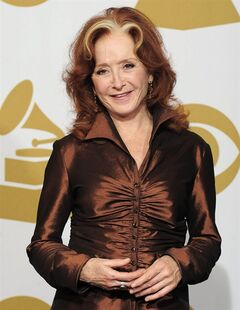 FILE - In this Feb. 12, 2012 file photo, singer Bonnie Raitt poses backstage at the 54th annual Grammy Awards in Los Angeles. (AP Photo/Mark J. Terrill, File)