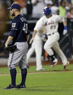 Milwaukee Brewers starting pitcher Marco Estrada (41) reacts as New York Mets' Taylor Teagarden (23) runs the bases after hitting a grand slam home run during the sixth inning of a baseball game Tuesday, June 10, 2014, in New York. (AP Photo/Frank Franklin II)