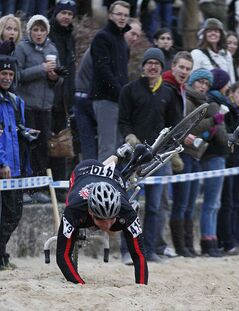 Luke Enns (419) takes a spill in the sandpit in the 2013 Manitoba Cyclocross Championships at The Forks Sunday.