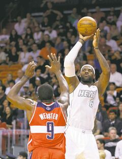 Miami Heat's LeBron James shoots over Washington's Martell Webster on Saturday.