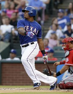 Texas Rangers' Adrian Beltre follows through on a single to right off a pitch from Los Angeles Angels starting pitcher Garrett Richards as catcher Hank Conger watches in the third inning of a baseball game, Friday, July 11, 2014, in Arlington, Texas. (AP Photo/Tony Gutierrez)