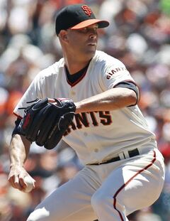 San Francisco Giants pitcher Tim Hudson throws to the Cincinnati Reds during the first inning of a baseball game, Sunday, June 29, 2014, in San Francisco. (AP Photo/George Nikitin)