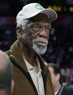 FILE - IN this Feb. 16, 2013, file photo, former Boston Celtis' Bill Russell watches the NBA All-Star Saturday Night basketball competition in Houston. Celtics officials say the NBA Hall of Famer is doing OK after collapsing during a speaking engagement near Lake Tahoe, Nev., Thursday, July 17, 2014. (AP Photo/Eric Gay, File)