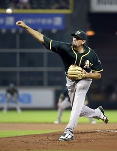 Oakland Athletics starting pitcher Jason Hammel throws against the Houston Astros during the first inning of a baseball game Wednesday, July 30, 2014, in Houston. (AP Photo/David J. Phillip)