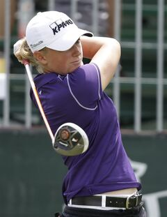 Stacy Lewis watches her tee shot on the first hole during the second round of the Kingsmill Championship golf tournament at the Kingsmill resort in Williamsburg, Va., Friday, May 16, 2014. (AP Photo/Steve Helber)