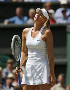 Maria Sharapova of Russia looks up after losing a point to Angelique Kerber of Germany during their women's singles match at the All England Lawn Tennis Championships in Wimbledon, London, Tuesday, July 1, 2014. (AP Photo/Ben Curtis)