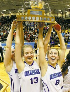 The jubilant Oak Park Raiders celebrate after winning the AAAA provincial high school basketball championship.