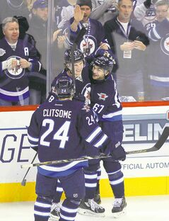 The good: Michael Frolik lights the lamp for the Winnipeg Jets Thursday night, pumping up the MTS Centre fans.