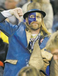 Winnipeg Blue Bombers' fan shows his feelings after BC Lions score their second touchdown during the first half of CFL action in Winnipeg Friday, September 27, 2013.