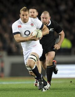 England's Chris Robshaw makes a break against New Zealand in their international rugby test at Eden Park in Auckland, New Zealand, Saturday, June 7, 2014. (AP Photo/SNPA, Ross Setford) NEW ZEALAND OUT