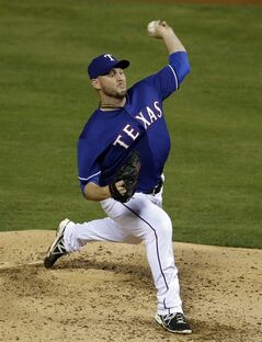 Texas Rangers starting pitcher Matt Harrison (54) delivers to the Colorado Rockies in the fifth inning of a baseball game, Thursday, May 8, 2014, in Arlington, Texas. The Rangers won 5-0. (AP Photo/Tony Gutierrez)