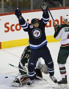 Winnipeg Jets forward Evander Kane celebrates a goal scored by  Zach Bogosian during second-period action Tuesday.
