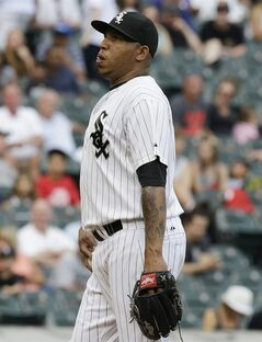 Chicago White Sox relief pitcher Ronald Belisario reacts during the eighth inning of a baseball game against the Minnesota Twins in Chicago, Sunday, Aug. 3, 2014. (AP Photo/Nam Y. Huh)