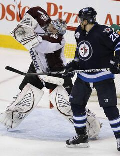 Winnipeg Jets' Blake Wheeler (26) looks for the rebound after Colorado Avalanche's goaltender Semyon Varlamov (1) makes the save in the third period.
