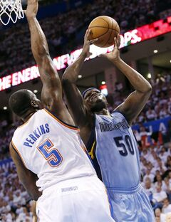 Memphis Grizzlies forward Zach Randolph (50) is fouled by Oklahoma City Thunder center Kendrick Perkins (5) as he shoots in the first quarter of Game 5 of an opening-round NBA basketball playoff series in Oklahoma City, Tuesday, April 29, 2014. (AP Photo)