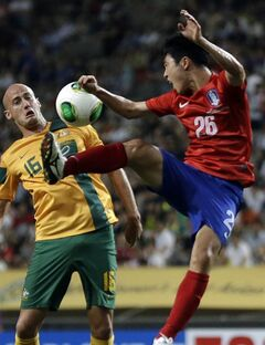 FILE - In this July 20, 2013 file photo, South Korea's Lee Seung-gi, right, fights for the ball against Australia's Ruben A. Zadkovic during their East Asian Cup soccer match at Seoul World Cup stadium in Seoul, South Korea. The second round of the Asian Champions League takes on extra emphasis for some World Cup hopefuls this week, with South Korea's Hong Myong-bo among the national team coaches carefully watching the continental club competition before announcing his squad for Brazil 2014. (AP Photo/Lee Jin-man, File)