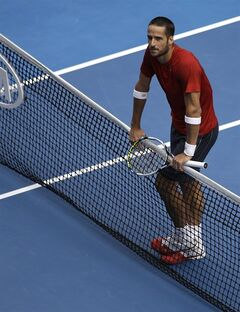 Feliciano Lopez of Spain rests on the net as he plays Andy Murray of Britain during their third round match at the Australian Open tennis championship in Melbourne, Australia, Saturday, Jan. 18, 2014.(AP Photo/Aijaz Rahi)