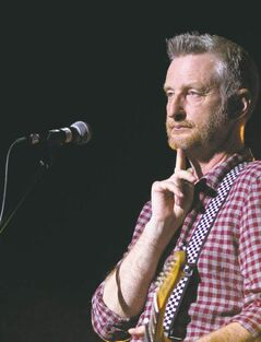 MONTREAL, QUE.: JULY 3, 2012 -- English musician Billy Bragg strikes a pose at the end of a song while in concert at the Metropolis as part of the Montreal International Jazz Festival in Montreal Tuesday, July 3, 2012. (John Kenney/THE GAZETTE)