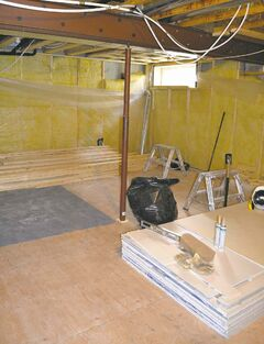 Basement reno as of Oct. 23 with old drywall removed from walls. Yellow fiberglass insulation and vapour barrier will be replaced with R-22 polyurethane spray foam to prevent moisture and air leakage.
