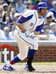Chicago Cubs' Nate Schierholtz watches his two-RBI triple against the Miami Marlins during the sixth inning of a baseball game on Sunday, June 8, 2014, in Chicago. (AP Photo/Andrew A. Nelles)