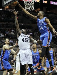 Oklahoma City Thunder's Kevin Durant (35) and San Antonio Spurs' DeJuan Blair (45) chase a rebound during the first half of an NBA basketball game, Monday, March 11, 2013, in San Antonio. (AP Photo/Darren Abate)