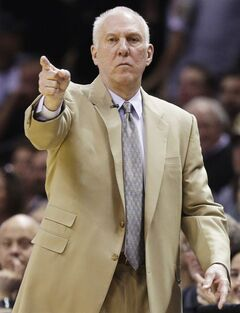 San Antonio Spurs head coach Gregg Popovich works the sideline against the Miami Heat during the first half in Game 2 of the NBA basketball finals on Sunday, June 8, 2014, in San Antonio.