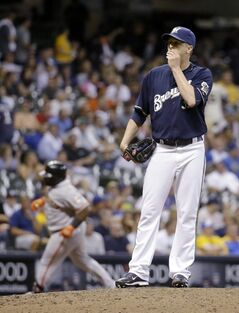Milwaukee Brewers relief pitcher Tom Gorzelanny reacts as San Francisco Giants' Pablo Sandoval rounds the bases on a two-run home run during the eighth inning of a baseball game Wednesday, Aug. 6, 2014, in Milwaukee. (AP Photo/Morry Gash)