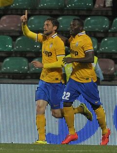 Juventus's Claudio Marchisio, left, celebrates with his teammate Kwadwo Asamoah of Ghana after scoring against Sassuolo during their Italian Serie A soccer match at Mapei stadium in Reggio Emilia, Italy, Monday, April 28, 2014. (AP Photo/Marco Vasini)