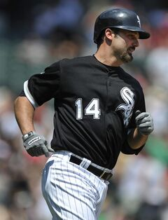 Chicago White Sox's Paul Konerko watches his solo home run during the second inning of an inter league baseball game against the San Diego Padres in Chicago, Sunday, June 1, 2014. (AP Photo/Paul Beaty)