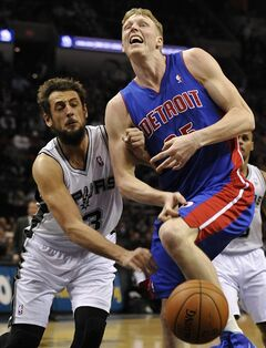 San Antonio Spurs guard Marco Belinelli, left, of Italy, slaps the ball away from Detroit Pistons forward Kyle Singler, right, during the second half of an NBA basketball game on Wednesday, Feb. 26, 2014, in San Antonio. San Antonio won 120-110. (AP Photo/Darren Abate)