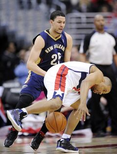 Washington Wizards guard Andre Miller, front, tries to get the ball against New Orleans Pelicans guard Austin Rivers (25) during the first half of an NBA basketball game Saturday, Feb. 22, 2014, in Washington. (AP Photo/Nick Wass)