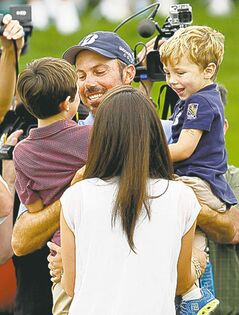 Matt Kuchar celebrates with his family after winning the Memorial.