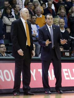 Miami head coach Jim Larranaga, left, and Duke head coach Mike Krzyzewski, right, talk before the NCAA basketball game in Coral Gables, Fla., Wednesday, Jan. 22, 2014. Duke won 67-46. (AP Photo/Alan Diaz)