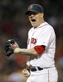Boston Red Sox's Jake Peavy reacts after getting the double play on Detroit Tigers' Victor Martinez in the fifth inning of a baseball game in Boston, Sunday, May 18, 2014. (AP Photo/Michael Dwyer)
