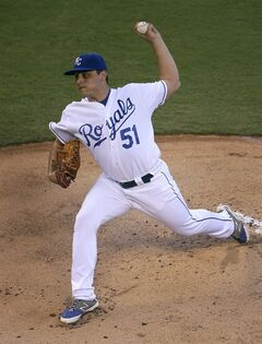 Kansas City Royals starting pitcher Jason Vargas throws during the first inning of a baseball game against the Cleveland Indians Friday, Aug. 29, 2014, in Kansas City, Mo. (AP Photo/Charlie Riedel)