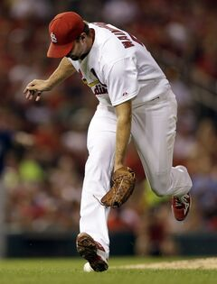 St. Louis Cardinals starting pitcher Adam Wainwright has trouble fielding a ball hit by Tampa Bay Rays' Ben Zobrist during the fifth inning of a baseball game Tuesday, July 22, 2014, in St. Louis. Wainwright was charged with an error on the play. (AP Photo/Jeff Roberson)