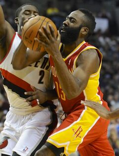 Houston Rockets's James Harden (13) shoots against Portland Trail Blazers' Wesley Matthews (2) during the first half of an NBA basketball game in Portland, Ore., Thursday Dec. 12, 2013. (AP Photo/Greg Wahl-Stephens)