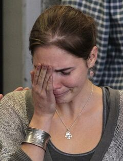 FILE - In this Tuesday, Oct. 4, 2011 file photo Amanda Knox becomes emotional as she sits down for a news conference shortly after her arrival at Seattle-Tacoma International Airport , in Seattle. Italy's highest criminal court has overturned the acquittal of Amanda Knox in the slaying of her British roommate and ordered a new trial. The Court of Cassation ruled Tuesday, March 26, 2013 that an appeals court in Florence must re-hear the case against the American and her Italian-ex-boyfriend for the murder of 21-year-old Meredith Kercher. (AP Photo/Elaine Thompson, file)