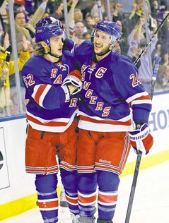 Rangers' Carl Hagelin, left, celebrates his second-period goal during Game 4 with Ryan Callahan.