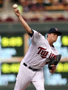 Minnesota Twins pitcher Kyle Gibson throws against the Tampa Bay Rays in the first inning of a baseball game, Friday, July 18, 2014, in Minneapolis. (AP Photo/Jim Mone)