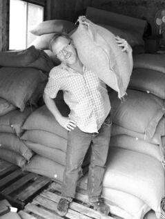 Derryl Reid with a container-load of coffee beans.