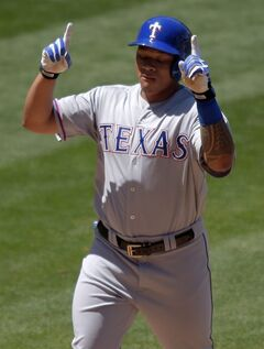 Texas Rangers' Michael Choice points to the sky after hitting a three-run home run during the fourth inning of a baseball game against the Los Angeles Angels, Sunday, May 4, 2014, in Anaheim, Calif. (AP Photo/Mark J. Terrill)