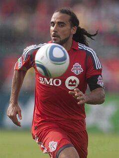 Toronto FC's Dwayne De Rosario eyes the ball in action in Toronto on July 24, 2010. Toronto FC chose the 35-year-old attacking midfielder with the third pick in Major League Soccer's Stage 2 Re-Entry Draft. THE CANADIAN PRESS/Chris Young