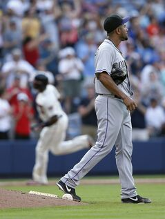 Colorado Rockies starting pitcher Franklin Morales paces on the mound as Atlanta Braves' Justin Upton, rear left, rounds third base with a two-run home run in the fifth inning of a baseball game, Sunday, May 25, 2014, in Atlanta. (AP Photo/John Bazemore)