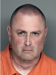 This undated booking photo provided by the Santa Barbara County Sheriff's Office shows Nicolas Holzer. Holzer, 45, told authorities he stabbed his parents, his two young sons and the family dog to death in their home because he believed it was his destiny, authorities said Tuesday, Aug. 12, 2014. Sheriff's deputies found the bodies of Nicolas Holzer's mother and father, and his sons, ages 10 and 13, in the home near the University of California, Santa Barbara, late Monday. They were summoned by Holzer, who told a police dispatcher in a calm, matter-of-fact voice that he had killed his relatives, authorities said. (AP Photo/Santa Barbara County Sheriff's Office)