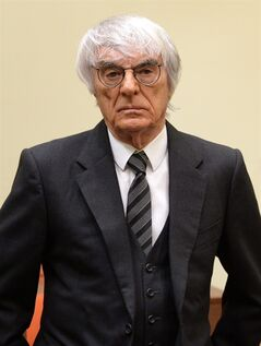 Formula One boss Bernie Ecclestone arrives for the fourth day of his trial at the courthouse in Munich, southern Germany, Tuesday, May 13, 2014. Ecclestone is charged with bribery and incitement to breach of trust